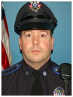 Patrolman Charles Turcotte of the Norton, Massachusetts Police Department rescued a woman who was unable to exit a burning car that had crashed.