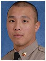 Trooper Joshua Kim of the Maryland State Police was on patrol when he saved a man who was trying to commit suicide by climbing over a concrete wall separating a roadway from a river 90 feet below.