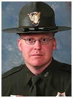Trooper William Kirkman of the Wyoming Highway Patrol helped free two young children who were pinned in an all-terrain vehicle that had crashed into a creek and were up to their necks in water.