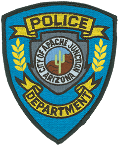 The center of the Apache Junction, Arizona, Police Department's patch features the official city seal. A saguaro cactus represents the Sonoran Desert, and behind it is a depiction of the legendary Superstition Mountains. An arrowhead surrounds the seal, acknowledging Native American influences.