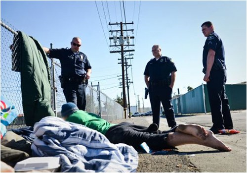Police Officers Interacting With Homeless Person