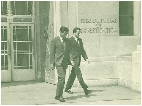 "Mr. Efrem Zimbalist, Jr. (left), and Mr. Stephen Brooks leave FBI Headquarters, Washington, D.C., on an important ""assignment."" Mr. Zimbalist, as Inspector Lew Erskine, and Mr. Brooks, as Special Agent Jim Rhodes, play the leading roles in the new ABC television series, ""The FBI,"" which is scheduled for viewing in color by the TV public beginning September 19, 1965."