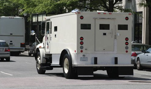An armored car on a city street. © Thinkstock.com