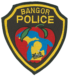 Bangor, Michigan, Police Department's patch portrays the state of Michigan surrounded by an apple—the city is a top apple producer. A train represents the toy train factory that provided Bangor with employment for years. The Great Lakes are depicted, which surround the state.