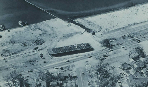 Hurricane Camille smashed into the Mississippi Gulf Coast on Sunday night, August 17, 1969. A barge pushed onto U.S. Highway 90 by the winds and high tides was refloated by means of a dike lined with plastic.