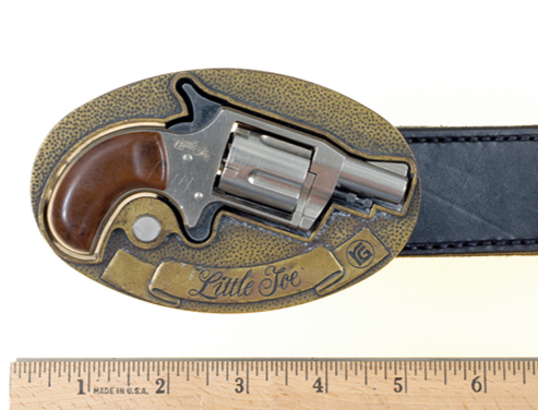 This small metal revolver is released from a belt buckle by the press of a button. Offenders may attempt to use this concealed weapon against law enforcement.