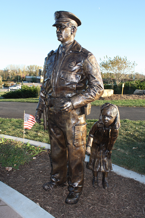 Dedicated on October 14, 2010, the Eagan, Minnesota Tribute and Memorial Plaza is located in the city's central park. Life-size bronze statues of a patrol officer shielding a frightened little girl stand proudly in the public park.