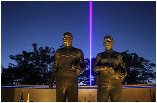 "The blue laser over the Orange County Peace Officers' Memorial represents ""The Thin Blue Line."""