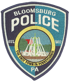 Formed before 1870, the Bloomsburg, Pennsylvania, Police Department serves citizens of the town and students at Bloomsburg University of Pennsylvania. Its patch shows the town fountain, located in Market Square—the center of the downtown area—near a civil war monument. The county seat of Columbia County, Bloomsburg is its largest community and Pennsylvania's only incorporated town.