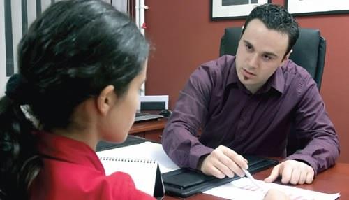 Boss Talking to Employee (Stock Image)