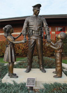Depiction of The Guardian statue honoring the men and women of the Gurnee Police Department, and all law enforcement officers in general, for their service and sacrifice in protecting others.