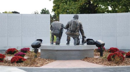 A depiction of Michigan's only monument honoring both police officers and firefighters who lost their lives in the line of duty.