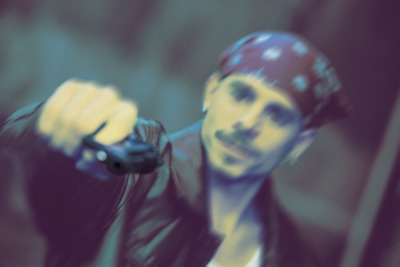 Depiction of a gang member with a handgun.