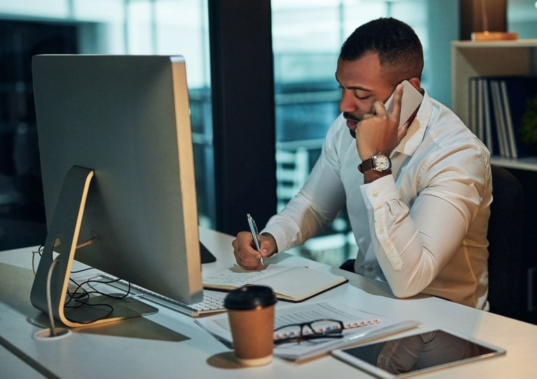 A stock image of a business man working.