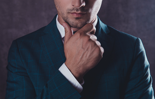 A business man is depicted with his hand on his chin thinking about business.