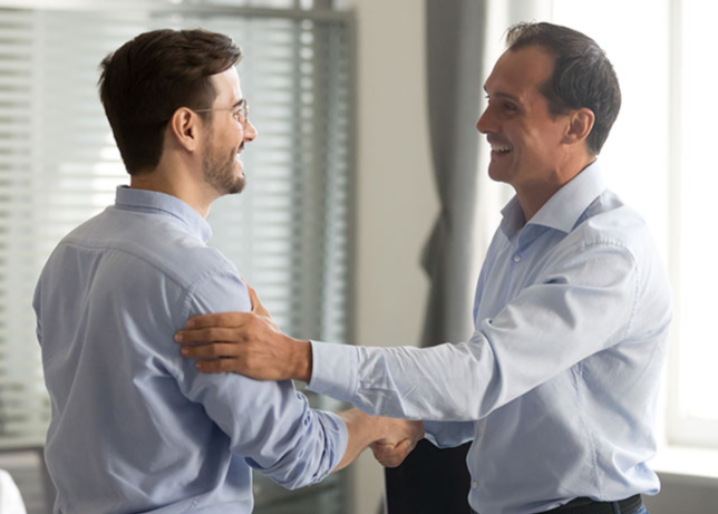 A stock image of two business men shaking hands.