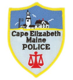 The patch of the Cape Elizabeth, Maine Police Department features the scales of justice and the Portland Head Light. The oldest lighthouse in Maine, it was commissioned by George Washington in 1791 and has guided maritime traffic for over 200 years.