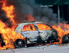 A car engulfed in flames. © Photos.com