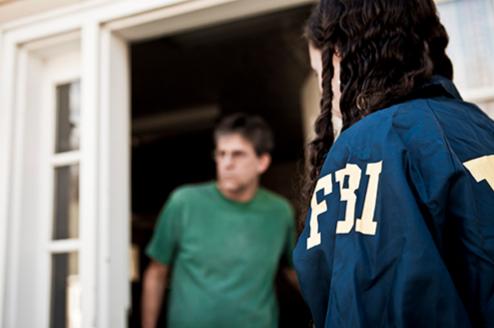 FBI Agent at Suspect's Door