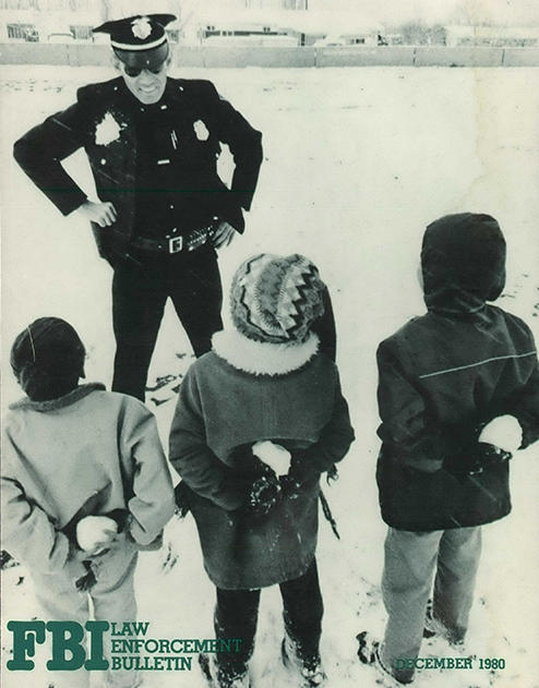 Children Playing in Snow and Talking to Police Officer (December 1980)