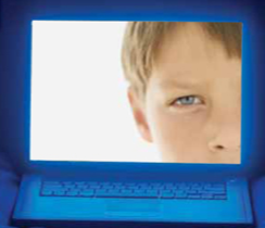 A child looks out from a laptop screen. © Photos.com