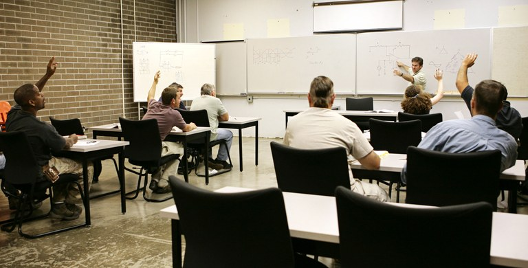 Stock image of a classroom setting.