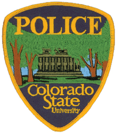 The patch of the Colorado State University Police Department in Fort Collins features the school's prominent stone-columned Administration Building as seen from the south end of the Oval, an expansive park one-quarter mile around. The Oval has been a center of activity on the campus since 1909 and is lined with 65 American elm trees, some of which are depicted on the police department patch. A number of other academic and administrative buildings line this green area, the oldest of which was built in 1881, 11 years after the university's founding.