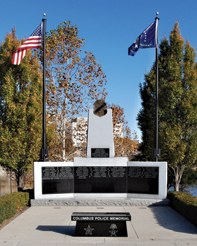On May 26, 2000, the Columbus, Ohio Division of Police memorial was dedicated. The original design was created by retired officer Tom Hayes, who became the division's sketch artist after he was shot and paralyzed in 1979 when he responded to a disturbance between two teenagers.
