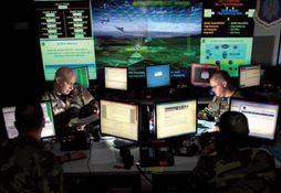 Depiction of computer terminals at a command post.