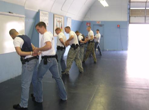 Law enforcement personnel practice making arrests during training.