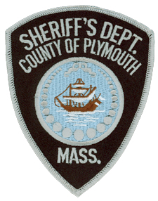 The County of Plymouth, Massachusetts, was established on June 2, 1685, by the General Court of Plymouth Colony. The patch of its sheriff's department shows the Mayflower at rest after landing its passengers on Plymouth Rock in 1620. Around the ship is a chaplet of 27 pearls, each representing the municipalities that form the county government.