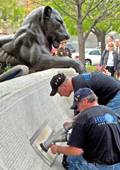 Two Denver-based craftsmen, Jim and Kirk, engrave the names of fallen law enforcement officers on the National Law Enforcement Officers Memorial. (Photos used with permission from the Law Enforcement Officers Memorial Fund.)