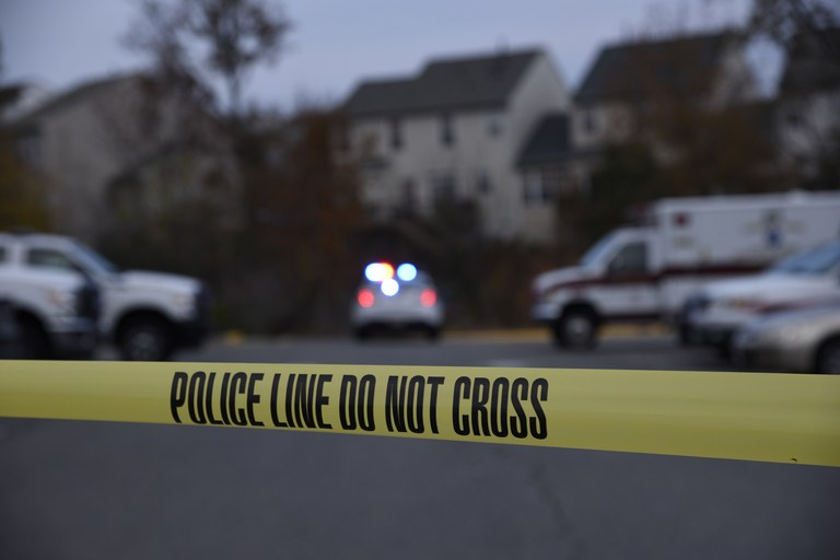 A stock image of a crime scene within a neighborhood.