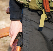 A close-up image of a man with a firearm.