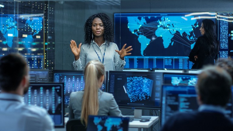 A stock image of a cyber classroom with a female instructor.