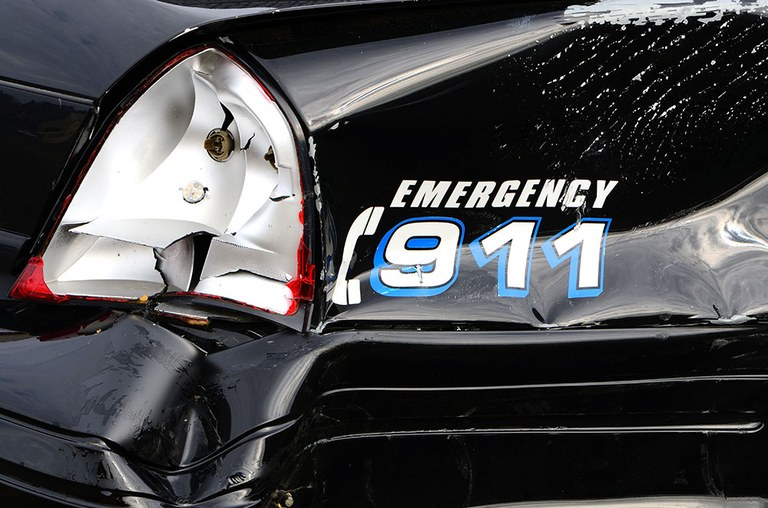 A stock image of a wrecked police vehicle.