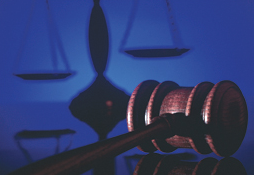 Dark Gavel and Scales of Justice (Stock Image)