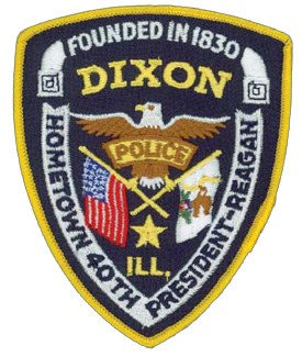 The patch of the Dixon, Illinois, Police Department represents several aspects of the town's history. Across the top, a white arch symbolizes Dixon's War Memorial Arch, and white letters state the town's founding year of 1830. The patch's border proudly highlights Dixon as the hometown of 40th President Ronald Reagan. Finally, the center graphics display the American and Illinois State fl ags beneath the bald eagle, honoring the state and nation that the department serves.