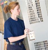 Police Woman Opening Locker