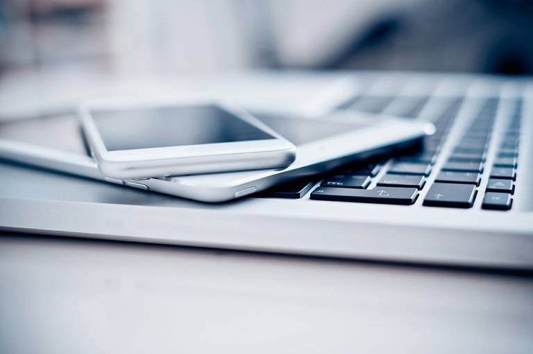 A stock image of a variety of electronic devices such as a cellphone, tablet, and laptop.