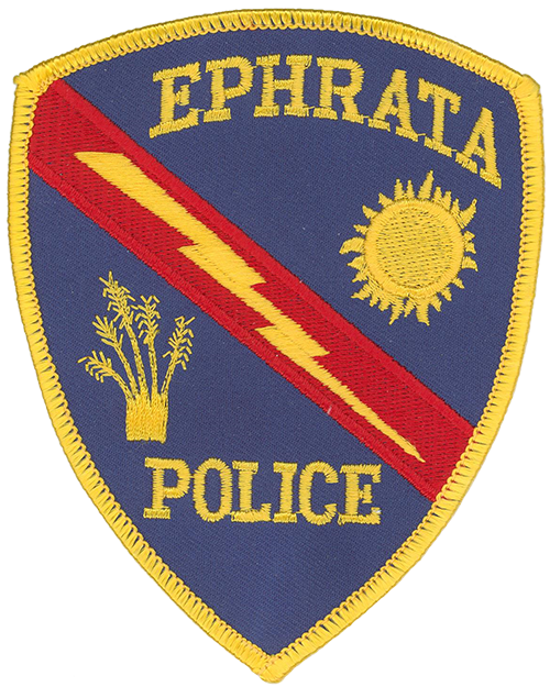 The Ephrata, Washington, Police Department's patch features the shining sun, which represents the city's location in the Sun Basin of the state's Columbia Basin area; a lightning strike, for the power generated by local dams; and wheat, which signifies the importance of agriculture to the local economy. The blue background celebrates the blue skies enjoyed in the city.