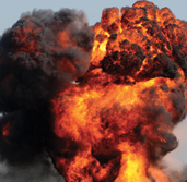 An explosion caused by a bomb or similar destructive device.