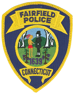 The town of Fairfield, Connecticut, was established in 1639 by Roger Ludlow, a framer of the Fundamental Orders of Connecticut, one of the world's first written constitutions for a self-governing people. The Fairfield Police Department was organized in August 1930 and serves a population of approximately 60,000 residents. Elements from the town's seal are featured in the center of the department's service patch. Amidst a background of trees and hills are two figures, a Native American and an English settler, grasping hands to seal a bargain. The foreground features the year of the town's founding.
