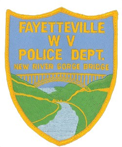The Fayetteville, West Virginia Police Department's patch has a depiction of the New River Gorge Bridge, the tallest in the Western Hemisphere at 876 feet above the water. It spans the New River, the second oldest, behind the Nile, in the world.