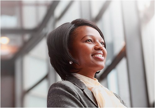 Stock photo of a business woman smiling in an office.