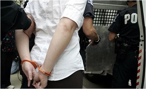 Female in Handcuffs (Stock Image)