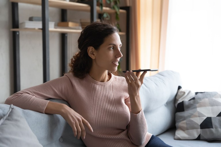 A stock image of a female talking on a cellphone.