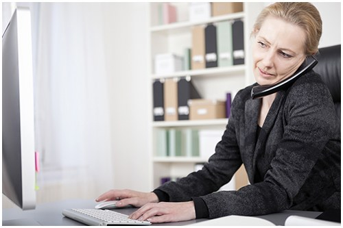 Female Working on Computer (Stock Image)
