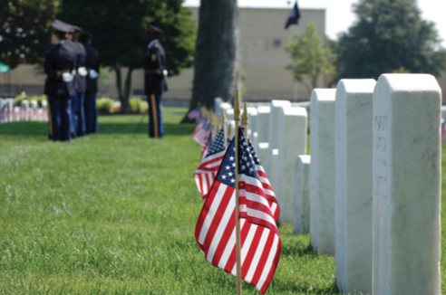 Flags are placed on the graves of fallen soldiers in remembrance of their lives of service.