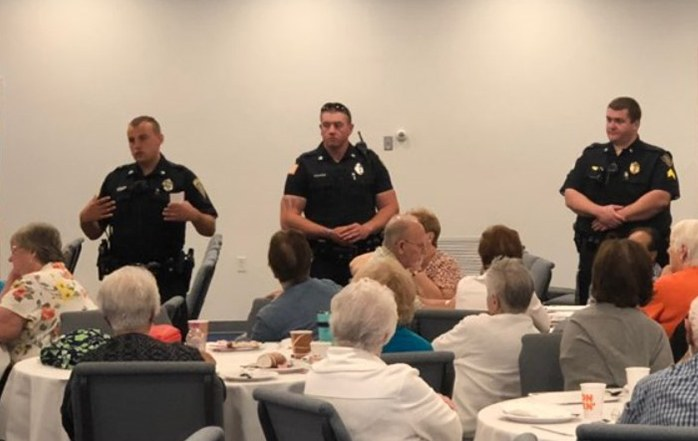 Officers from the Abington, Massachusetts, Police Department, conducting a Fraud Talks or Your Money Could Walk class for local seniors.